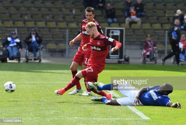 Kaiserslautern's Sebastian Kerk scores the 1-2 goal with teammate Christoph Moritz in the background during the 2. German Bundesliga soccer match...