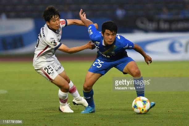 Kaishu Sano of Machida Zelvia and Kazune Kubota of Fagiano Okayama compete for the ball during the JLeague J2 match between Machida Zelvia and...