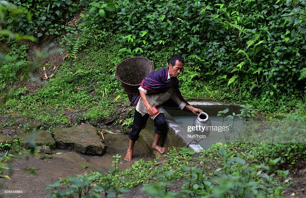 Kaisii Adaso, a 55 years old blind man fetch water from a