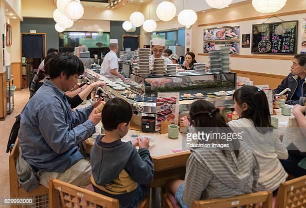 Kaitenzushi restaurant serving sushi on rotating conveyor belt Tsukiji fish market Tokyo Japan