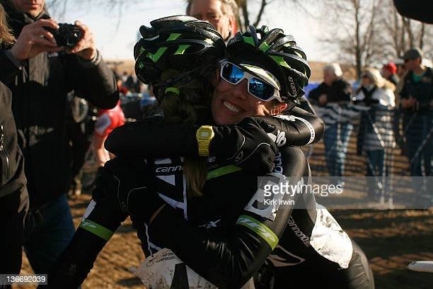Kaitlin Antonneau of the Cyclocrossworld/Cannondale is congratulated by teammate Nicole Duke after placing second place in the Women's Elite race and...