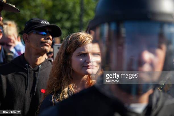 Kaitlin Bennett a a squad of Three Precenter Milita members and a wall of riot police tried to debate counter protestersKaitlin Bennett a former...