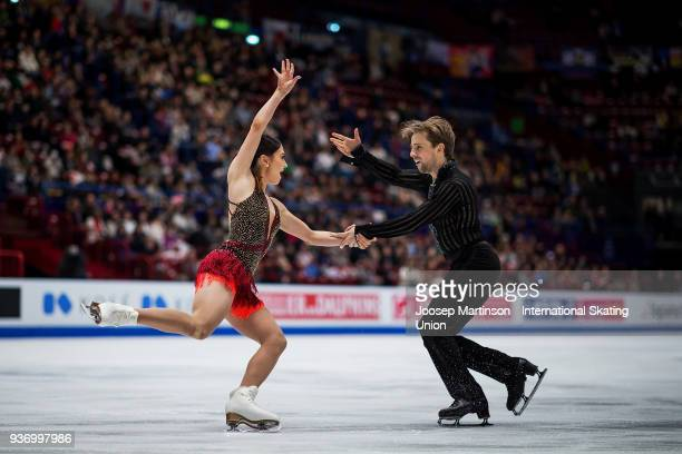 Kaitlin Hawayek and Jean Luc Baker of the United States compete in the Pairs Free Skating during day two of the World Figure Skating Championships at...