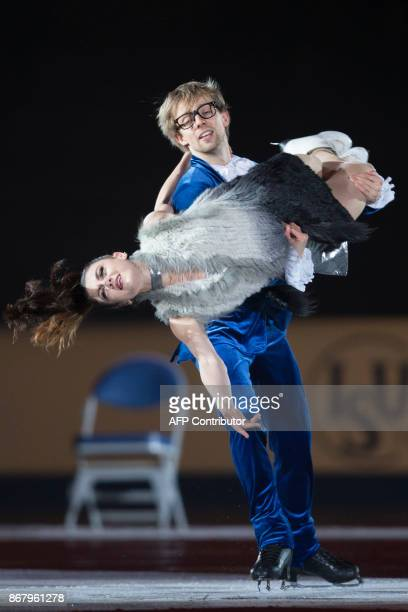 Kaitlin Hawayek and JeanLuc Baker of the United States skate their exhibition program at the ISU Grand Prix of Figure Skating's Skate Canada...