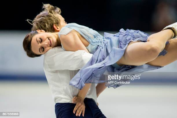 Kaitlin Hawayek and JeanLuc Baker of the US perform their free dance in the dance competition at the 2017 Skate Canada International ISU Grand Prix...