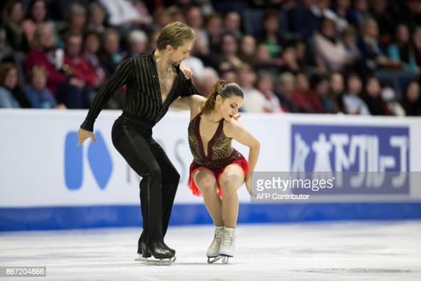 Kaitlin Hawayek and JeanLuc Baker of the US perform their short program at the 2017 Skate Canada International ISU Grand Prix event in Regina...
