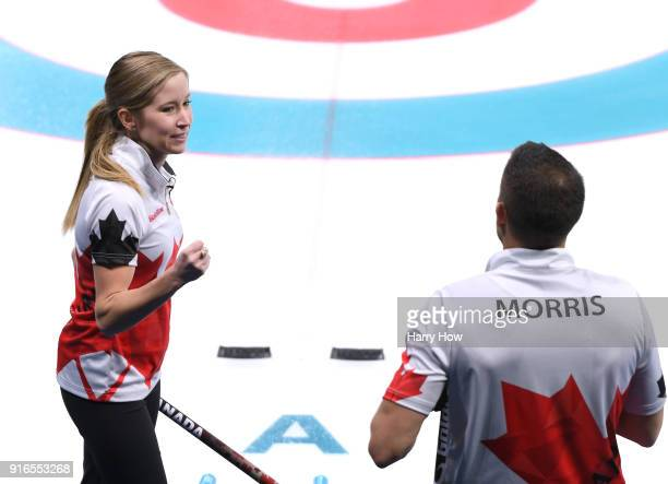 Kaitlin Lawes of Canada celebrates an 82 win with John Morris over the Olympic Athlete from Russia team during the Curling Mixed Doubles Round Robin...