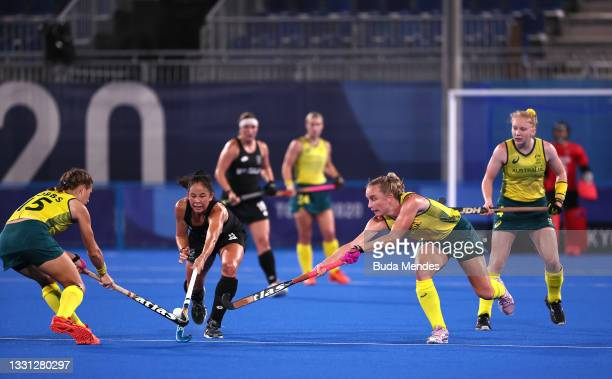 Kaitlin Nobbs and Jane-Anne Claxton of Team Australia battle for the ball with Julia King of Team New Zealand during the Women's Preliminary Pool B...