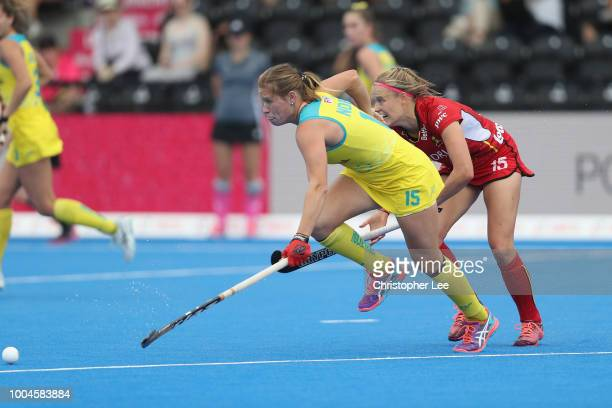 Kaitlin Nobbs of Australia gets away from AnneSophie Weyns of Belgium during the Pool D game between Australia and Belgium of the FIH Womens Hockey...