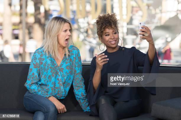 "Kaitlin Olson and Tanika Ray visit ""Extra"" at Universal Studios Hollywood on November 14, 2017 in Universal City, California."