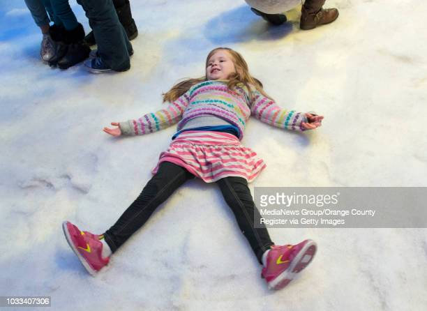 Kaitlyn Abbott of Visalia makes an snow angel in the real snow at Disney California Adventure's newest attraction Olaf's Snow Fest INFORMATION...