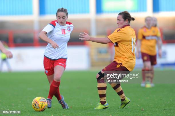 Kaitlyn Canavan of Spartans FC makes a run down the pitch while pressured by Hayley Cunningham of Motherwell FC during the SSE Scottish Women's Cup...