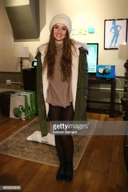 Kaitlyn Dever gets her hands on Wii Fit U while at the Nintendo Chalet during the 2014 Sundance Film Festival on January 18 2014 in Park City Utah