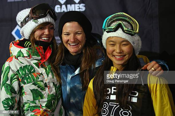 Kaitlyn Farrington in third place, Kelly Clark in first place and Chloe Kim in second place, pose for a photo after the women's Snowboard Superpipe...