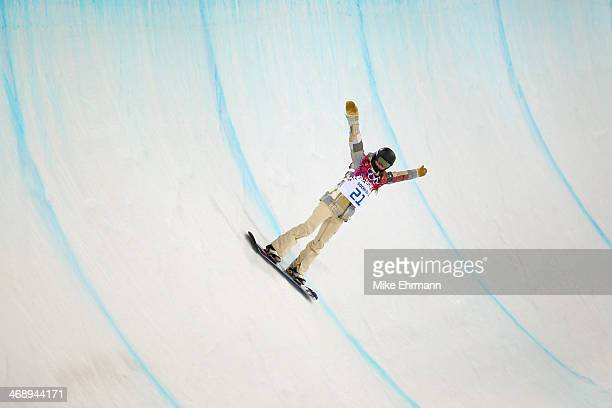 Kaitlyn Farrington of the United States celebrates in the Snowboard Women's Halfpipe Semifinals on day five of the Sochi 2014 Winter Olympics at Rosa...