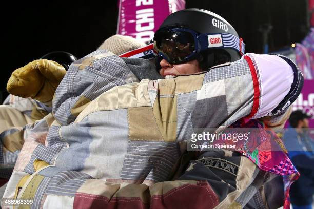 Kaitlyn Farrington of the United States celebrates winning gold in the Snowboard Women's Halfpipe Finals on day five of the Sochi 2014 Winter...