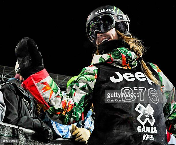 Kaitlyn Farrington waves to fans following a practice run just before competing in the Winter X-Games 2014 women's Snowboard Superpipe final at...