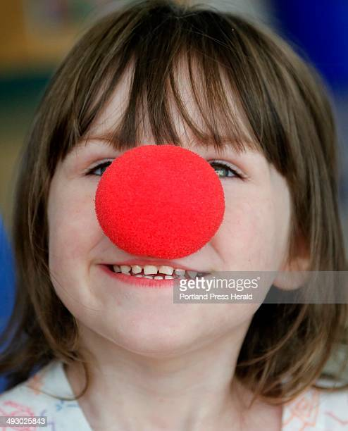 Kaitlyn Frost of Waterville tries on a clown nose as Circus Smirkus Big Top Tour makes a stop at The Barbara Bush Children's Hospital Photographed on...