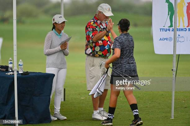 Kaitlyn Moreland high fives a volunteer during the 2021 Drive, Chip and Putt Regional Qualifier at TPC Scottsdale on September 26, 2021 in...