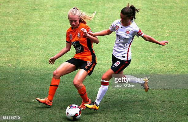 Kaitlyn Torpey of the Roar battles for posession with Rachel Lowe during the round 11 WLeague match between the Brisbane Roar and the Western Sydney...