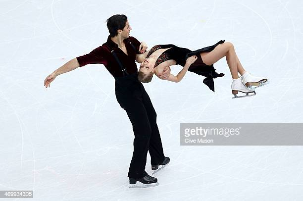 Kaitlyn Weaver and Andrew Poje of Canada compete in the Figure Skating Ice Dance Free Dance on Day 10 of the Sochi 2014 Winter Olympics at Iceberg...