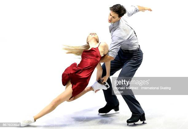 Kaitlyn Weaver and Andrew Poje of Canada perform in the ice dance free dance during the ISU Grand Prix of Figure Skating at Brandt Centre on October...
