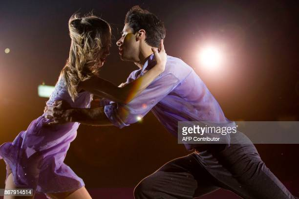 Kaitlyn Weaver and Andrew Poje of Canada perform their exhibition program at the 2017 Skate Canada International ISU Grand Prix event in Regina...