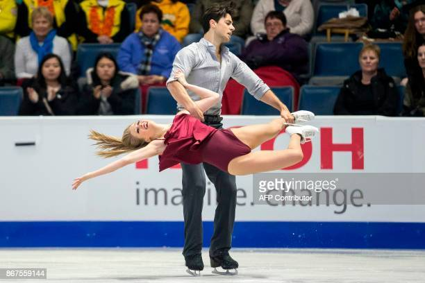 Kaitlyn Weaver and Andrew Poje of Canada perform their free dance in the dance competition at the 2017 Skate Canada International ISU Grand Prix...