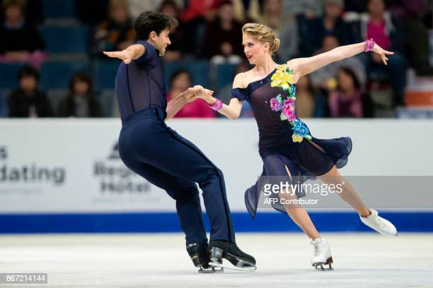 Kaitlyn Weaver and Andrew Poje of Canada perform their short program at the 2017 Skate Canada International ISU Grand Prix event in Regina,...