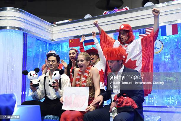 Kaitlyn Weaver and Andrew Poje of Canada react with their team mates at the kiss and cry after the Ice dance free dance during the 2nd day of the ISU...