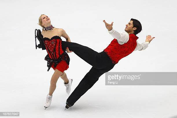 Kaitlyn Weaver and Andrew Poje of Canada skate in the Ice Dance Free Dance during ISU Grand Prix and Junior Grand Prix Final at Beijing Capital...