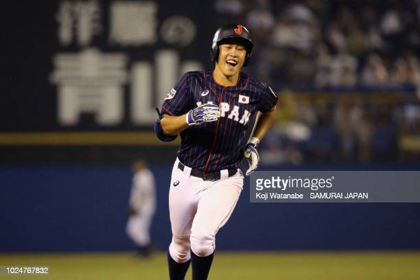 Kaito Kozono of Samurai Japan U-18 celebrates after hitting a solo homer in the 8th inning during the game between Samurai Japan High School IX and...