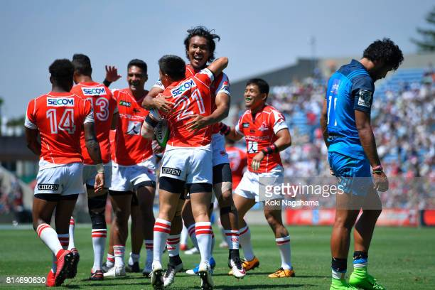 Kaito Shigeno of Sunwolves celebrates scoring a try with his teammates during the Super Rugby match between the Sunwolves and the Blues at Prince...