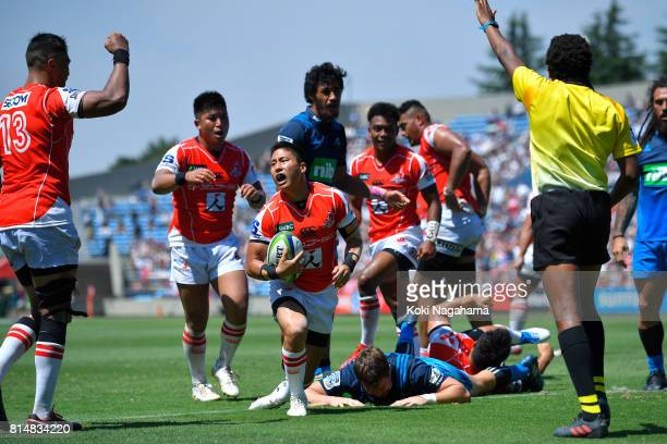 Kaito Shigeno of Sunwolves celebrates scoring a try with his teamates during the Super Rugby match between the Sunwolves and the Blues at Prince...
