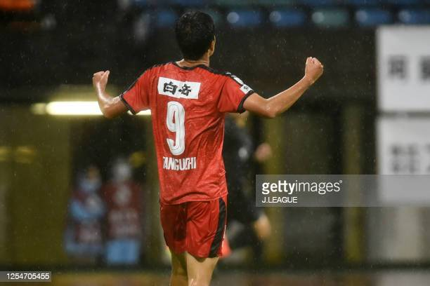 Kaito Taniguchi of Roasso Kumamoto celebrates scoring his side's third goal during the JLeague Meiji Yasuda J3 match between Roasso Kumamoto and...