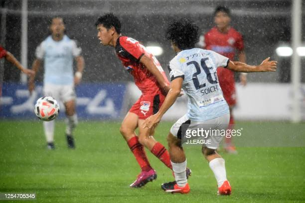Kaito Taniguchi of Roasso Kumamoto takes on Soichi Tanaka of Kagoshima United during the JLeague Meiji Yasuda J3 match between Roasso Kumamoto and...