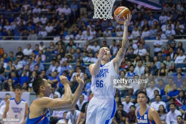 KaiYan Lee escapes the defense of Japeth Aguilar of Gilas Pilipinas Gilas Pilipinas defended their home against Chinese Taipei Game ended at 90 83