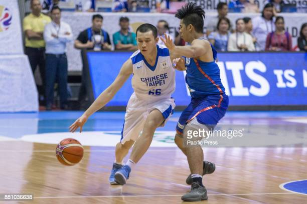 KaiYan Lee of Chinese Taipei defended by Kiefer Ravena of Gilas Pilipinas Gilas Pilipinas defended their home against Chinese Taipei Game ended at 90...