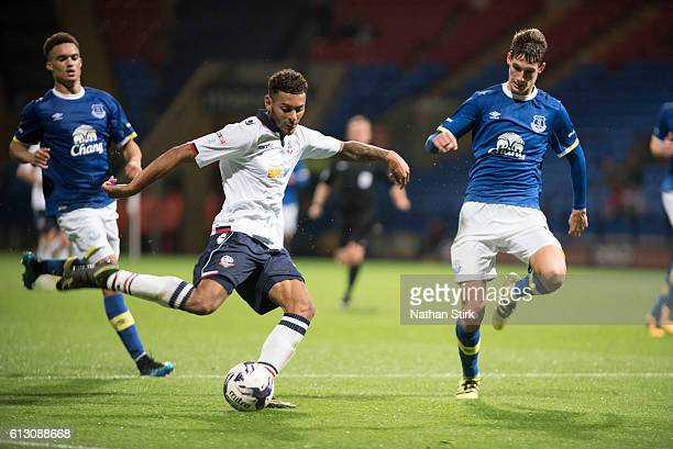 Kaiyne Woolery of Bolton Wanderers and Mathew Foulds of Everton during the Checkatrade Trophy group match between Bolton Wanderers and Everton...