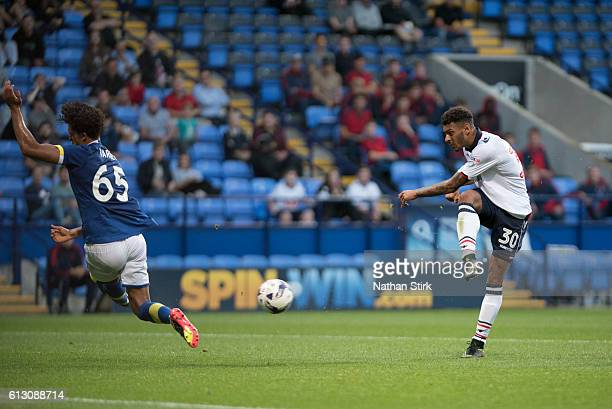 Kaiyne Woolery of Bolton Wanderers shot is blocked by Everton's Josef Yarney during the Checkatrade Trophy group match between Bolton Wanderers and...