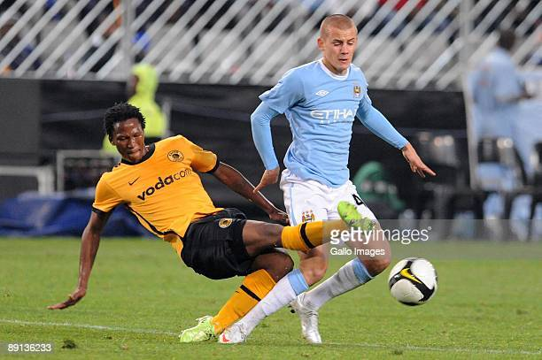 Kaizer Chiefs defender Jeffrey Ntuka tackles Vladimir Weiss of Manchester City during the 2009 Vodacom Challenge match between Kaizer Chiefs and...
