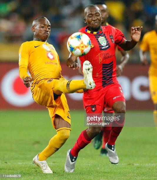 Kaizer Chiefs FC 's Zimbabwean international Khama Billiat fights for the ball against TS Galaxy Terrence Mashego during the Nedbank Cup Soccer Final...