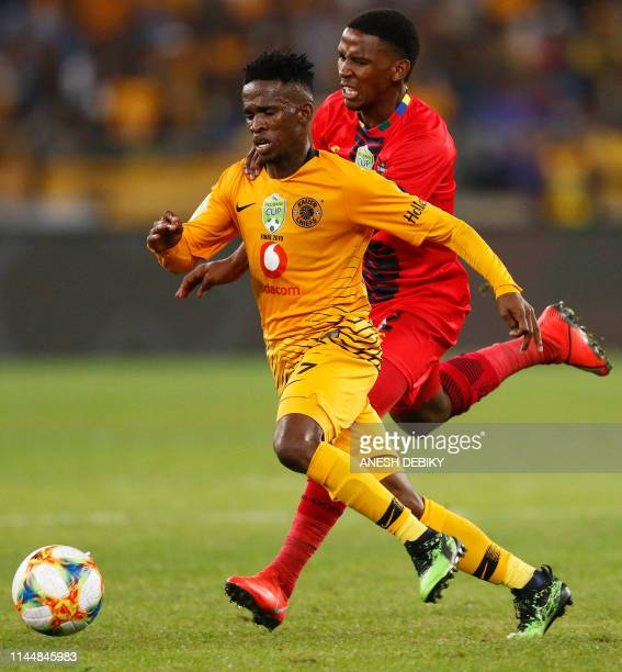Kaizer Chiefs FC's Kabelo Mahlasela vies for the ball against TS Galaxy's Nation Ndlovu during the Nedbank Cup Soccer Final held at the Moses Mabhida...
