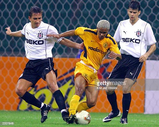 Kaizer Chiefs player Stanton Fredericks fights for the ball with Besiktas JK's Emre Asik and Ronaldo Guiaro during the PeaceCup 2003 Korea in Busan...