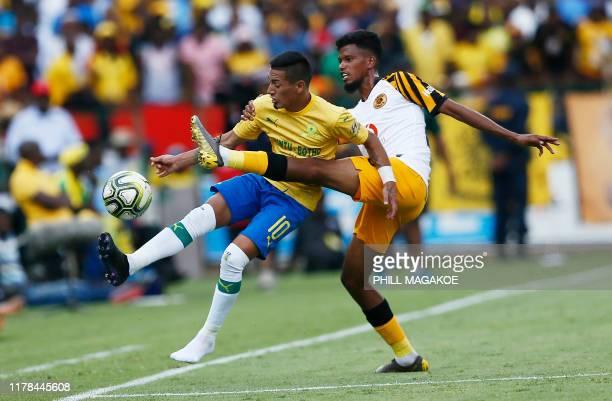Kaizer Chiefs' South African defender Yagan Sasman fights for the ball with Mamelodi Sundowns' Urugyan forward Gaston Sirino during the ABSA Premier...