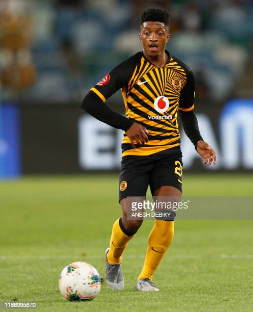 Kaizer Chiefs' South African midfielder Dumisani Zuma runs with the ball during the Premier Soccer League match between Kaizer Chiefs and...