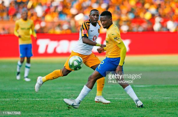 Kaizer Chiefs' South African midfielder George Maluleka fights for the ball with Mamelodi Sundowns' South African defender Motjeka Madisha during the...