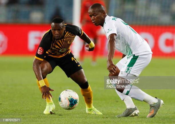 Kaizer Chiefs' South African midfielder George Maluleka fights for the ball with Bloemfontein Celtic's South African midfielder Mzwanele Mahashe...