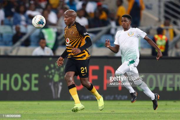 Kaizer Chiefs' South African midfielder Lebogang Manyama runs with the ball during the Premier Soccer League match between Kaizer Chiefs and...