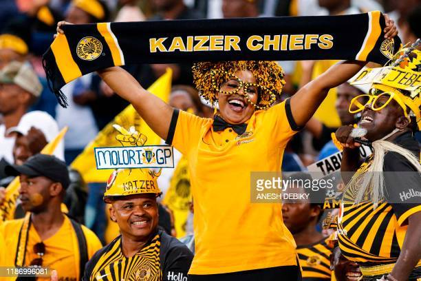 Kaizer chief's supporters cheer for their team during the Premier Soccer League match between Kaizer Chiefs and Bloemfontein Celtic at the Moses...